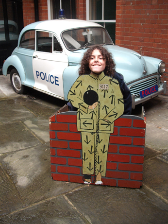 Jake being far too tall to really fit behind the convict mock up