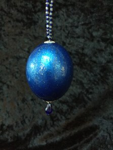 Blue and glitter painted egg.