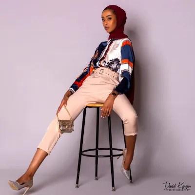 fashion model sitting on stool