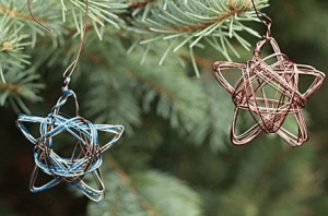 Wire craft stars hanging on Christmas tree