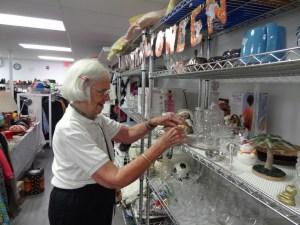 st james thrift shop volunteer filling shelves