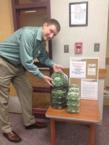 Dr. Longley in the lobby of the Livingston Family Medicine Center with the farm's produce.