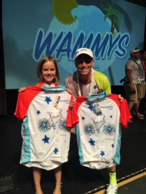 Lee Benjamin poses with Wish Kid Lily, who designed next year's bike jersey for riders who are the highest fundraisers.