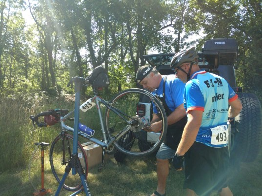 So thankful for bike mechanics. Patrick fixes Nick Graham's bike so he can keep on riding.