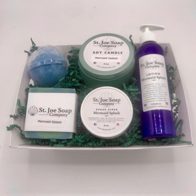 image of Mermaid Splash Gift Basket with assorted soaps, candles, sugar scrub and lotion, and bath bomb