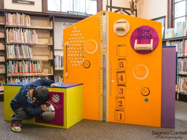 A child playing at the St. Johns library.