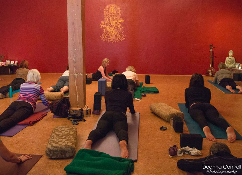 Studio at Shanti Om Yoga with a class in session.
