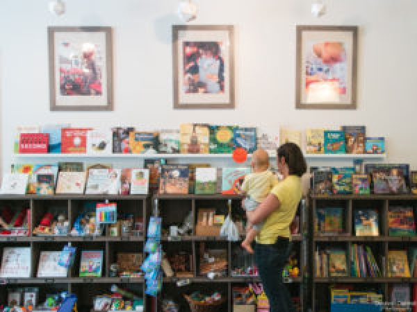 Mom and baby viewing a wall of books