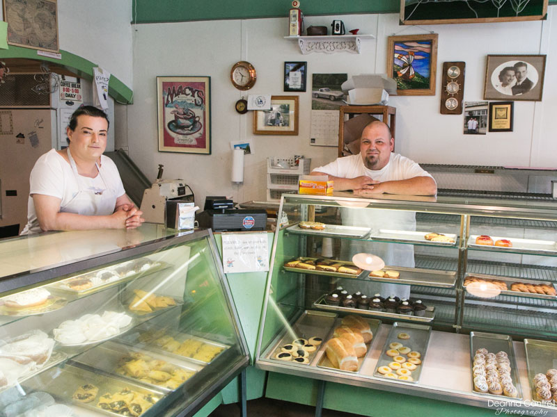 Kat and James Gilbert behind the counters of their popular pastry shop.