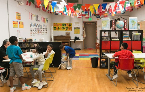 Children in a colorful classroom at the St. Johns Racquet Center.