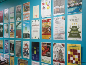 Wall with event flyers.