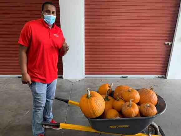 Reggie Guyton with wheelbarrow of pumpkins
