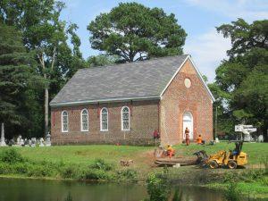 brick church, machinery, tree