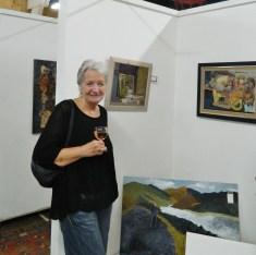 Ann Hickebottom next to her work