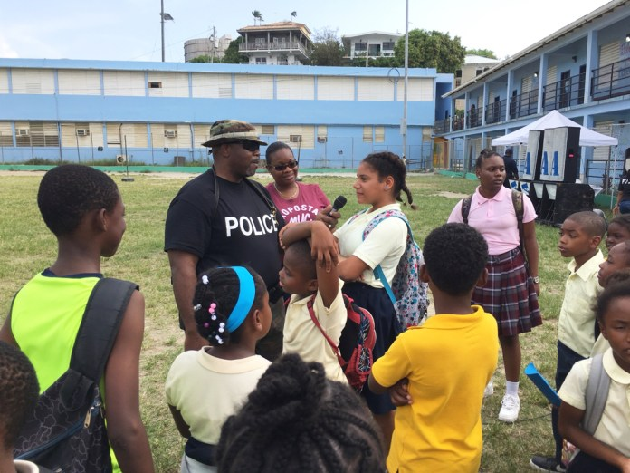 Students ask Officer Ecedro Lindquist questions following the demonstration during National Police Week activities on St. John.