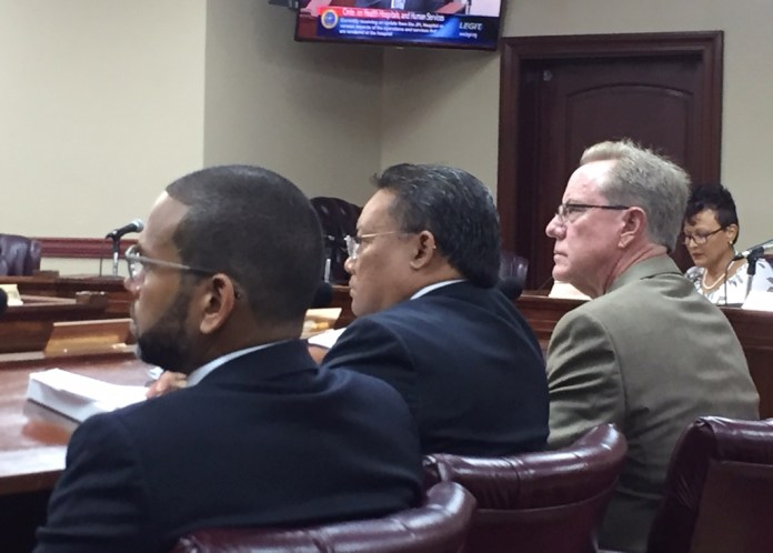 From left, Troy de Chabert Schuster, Richard Evangelista and Tim Lessing testify before the Senate on behalf of the Juan F. Luis Hospital Friday.