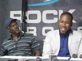 Trainer David Rogers, Sr. gives V.I. boxer Clayton Laurent, Jr. some support during Wednesday's news conference.