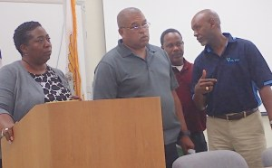 From left, Ann Hanley, wastewater director, Vince Ebbesen, solid waste director, Elvis Pemberton, wastewater manager and Roger E. Merrit, Jr. executive director, listen to questions at Waste Management Authority town hall meeting.