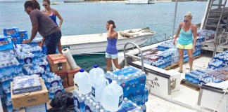 Volunteers load supplies aboard Caribbean Sea Adventures vessel Thursday for hurricane victims on St. Thomas, St. John and Water Island. (Photo by Sarah Ridgway)