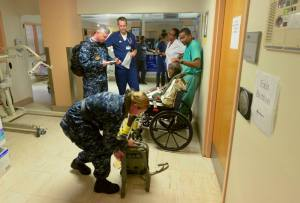 Sailors from Wasp help evacuate patients from Schneider Regional Medical Center. (Navy photo)