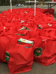 Bright red bags of goods from Tim Duncan's 21 USVI Hurricane Help are lined up in Frederiksted on Sunday. (Ivy Hunter photo)