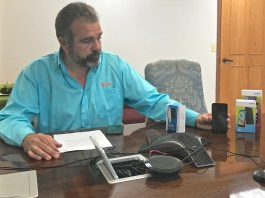 Viya CEO Alvaro Pilar demonstrates how various wireless devices work. (James Gardner photo)