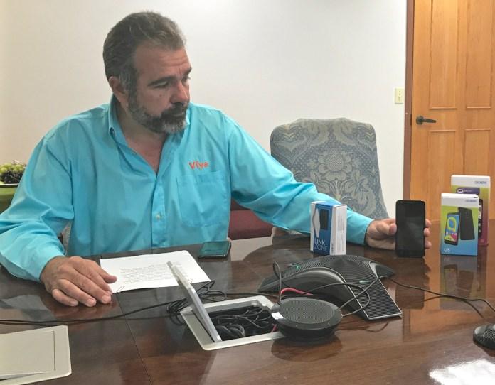 Viya CEO Alvaro Pilar demonstrates how various wireless devices work. (James Gardner photo)