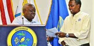 Gov. Kenneth Mapp announces the appointment of Clifford Graham, right, as chairman of the V.I. Hurricane and Resiliency Advisory Group during a news conference Monday. (Photo provided by Government House)
