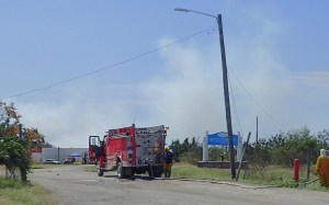 A fire truck blocks the entrance to the Anguilla Landfill. (Susan Ellis photo)
