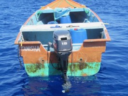 Eight men and three women were taken from this 19-foot vessel in the Mona Passage. (U.S. Coast Guard photo)