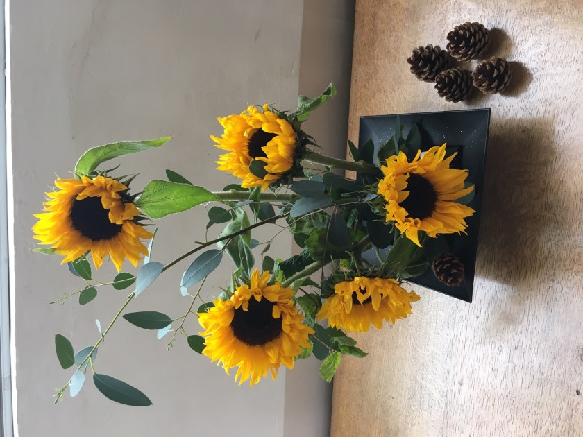 sunflowers on a side table.