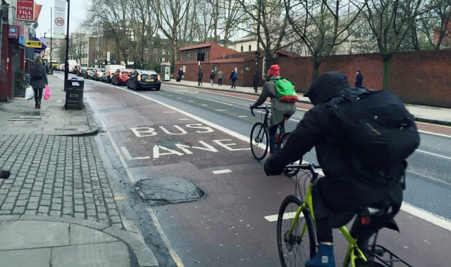 Pothole-riddled roads in Old Street makes it hard for cyclists to stay in the left gutter cyclist sanctuary. Photo credit: Valerie Browne