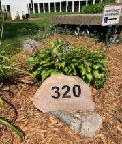 320 address on rock in front of church