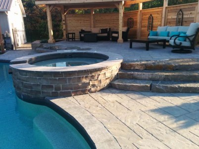 hot tub attached to pool