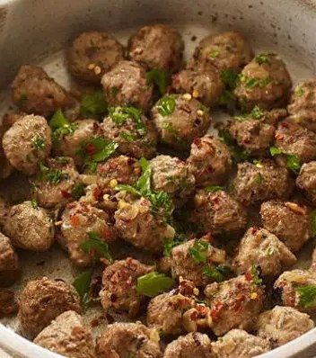 Serve these bite-size Weight Watchers Italian Meatballs as an appetizer or hors d'oeuvre, or combine with pasta or rice for a main course.