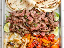 All it takes is a simple marinade and a screaming hot grill to put together this amazing platter of steak fajitas.