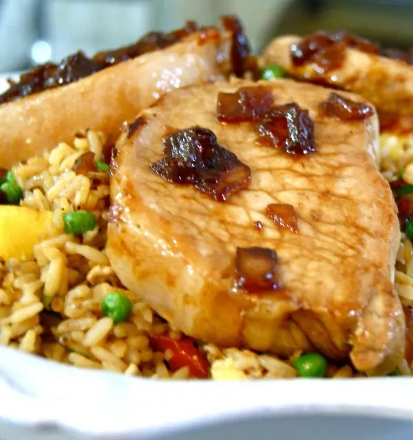 This recipe for Sweet Soy Glazed Pork Chops with Pineapple Fried Rice is a great mix of salty and sweet and a delicious Asian-inspired twist on classic pork chops.