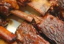 An easy recipe for Sweet and Spicy Baby Back Ribs that are falling-off-the-bone tender, as you might expect.