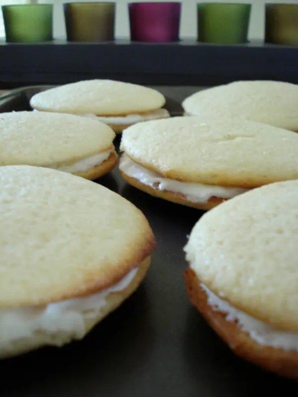 The original Whoopie Pie is actually chocolate cake cookie filled with a fluffy white icing, so these Lemon Whoopie Pies are quite the twist, but delicious no less.