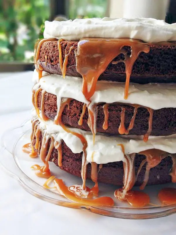 You need this Caramel Macchiato Cake in your life! It has everything you love about the classic Starbucks drink: 3 layers of rich espresso cake, whipped cream frosting, and caramel filling!
