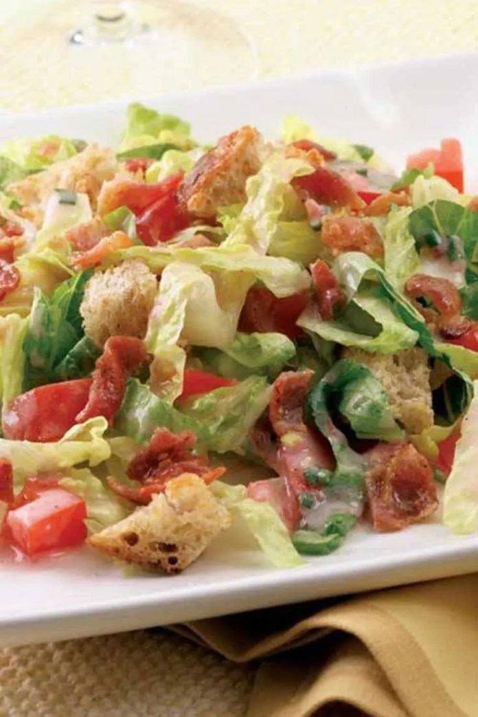 The whole family will love this quick and easy recipe based on the classic BLT sandwich. Crisp Romaine lettuce, bacon, tomatoes and cubed bread are tossed with a creamy tomato and chive dressing. #salad #BLT #bacon