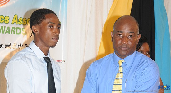 President of the St Lucia Athletics Association Cornelius Breen (r) presented the Senior Athlete of the Year Award to Albert Reynolds.