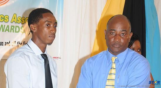 President of the St Lucia Athletics Association Cornelius Breen (r) presented the Senior Athlete of the Year Award to Albert Reynolds.