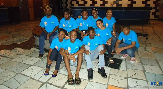 Nilka Gonzague (far left) with members of Youth on Fire Ministry: Changing the lives of the youth in Anse La Raye.