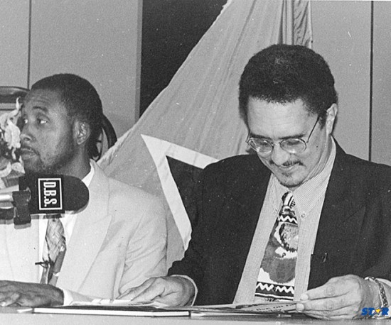 Since this 1998 press conference when this picture was taken, much dirty water has flowed under Saint Lucia's most famous bridge!