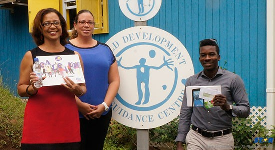 A member of LiiVE Productions (right) presents donations to representatives of CDGC.