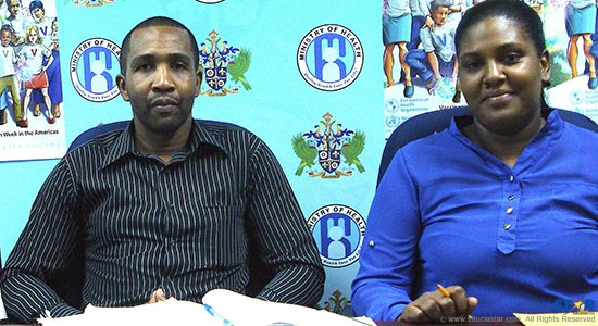 Health Officer Emerson Vitalis with Glenda Etienne-Cepal, Vector Control Manager at a news conference.