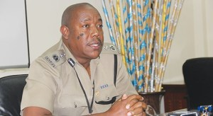 Acting Commissioner of Police Errol Alexander speaking to reporters at a press briefing Tuesday.