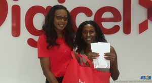 Digicel's Louise Victor presents Julia Cadette with her tickets and her travel essentials.