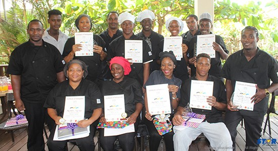 The winning chefs and participants show off their awards and certificates.